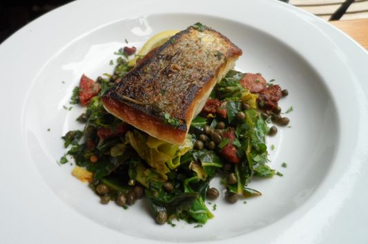 Hake with cannelloni beans, chorizo, spring greens and caper sauce