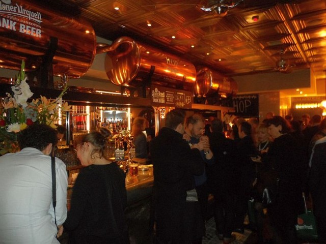 Galvin HOP launch party - bar showing the polished copper tanks from which the draft beers flow
