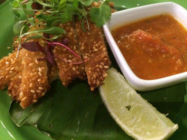 Sesame-coated chicken tapas dish