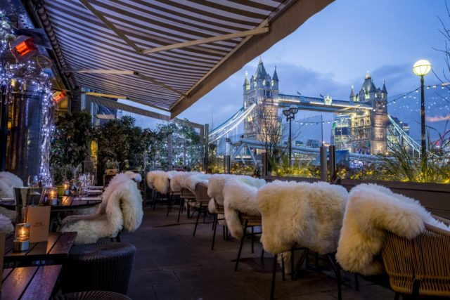 Terrace area with spectacular view of Tower Bridge dressed for winter dining